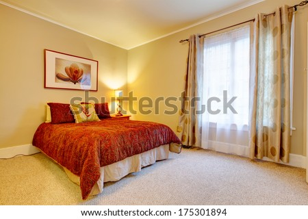 Bright Bedroom With Beige Carpet Floor And Yellow Walls. Red Bedding And Red Frame Wall Picture Accomplish Design