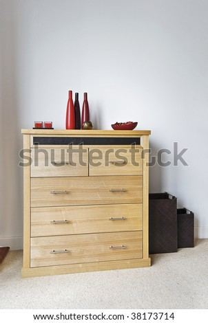 bright birch wood chest of drawers with decoration