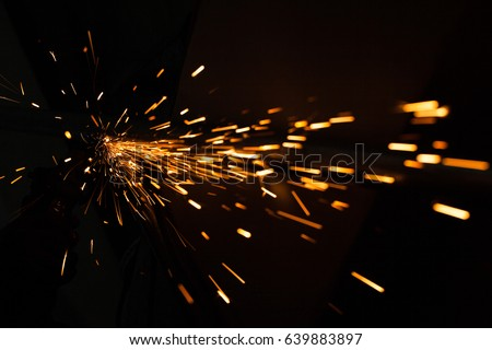 Bright blue and yellow sparks on a black background. Magical lig #639883897