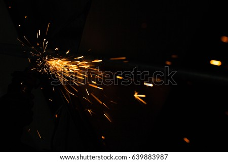 Bright blue and yellow sparks on a black background. Magical lig #639883987
