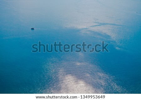 Bright blue brilliant sea from a great height (aerial photo from a paraglider), summer holidays in the Caucasus in Abkhazia. Saturated colors. #1349953649