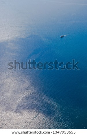 Bright blue brilliant sea from a great height (aerial photo from a paraglider), summer holidays in the Caucasus in Abkhazia. Saturated colors. #1349953655