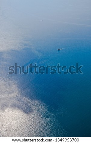 Bright blue brilliant sea from a great height (aerial photo from a paraglider), summer holidays in the Caucasus in Abkhazia. Saturated colors. #1349953700