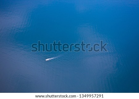 Bright blue brilliant sea from a great height (aerial photo from a paraglider), summer holidays in the Caucasus in Abkhazia. Saturated colors. #1349957291