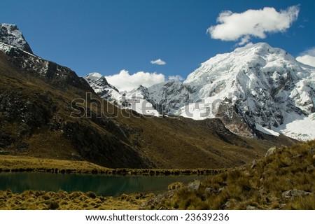 bright blue lake in the cordillera blanca, peru - stock photo