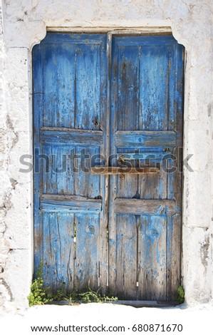 bright blue old weathered door...