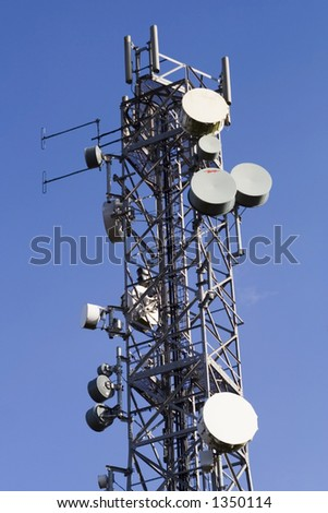 Bright blue sky and cell phone transmitter tower.