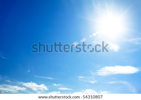 bright blue sky with the sun causing lens flare