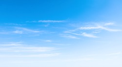 Bright Blue sky with white clouds over the horizon in summer sunny day. Beautiful Nature sky background, texture for Design. Natural cloudy Wallpaper or Web banner With Copy Space