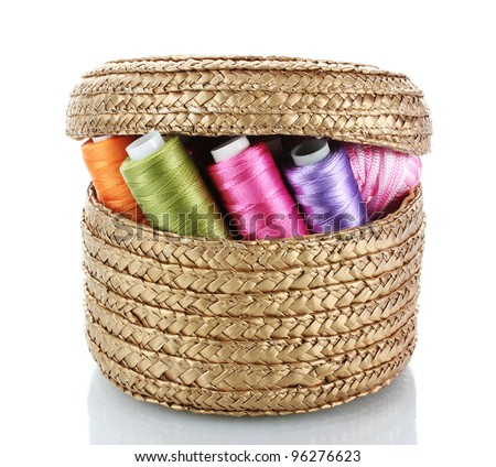bright bobbin thread in basket isolated on white