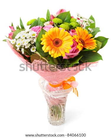 Bright bouquet in crystal vase isolated on white background