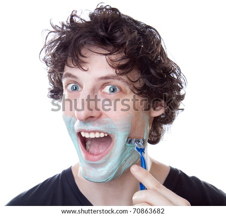 Bright caucasian man shaving in the bathroom at home