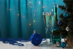 Bright Christmas background with champagne glasses and Christmas balls. New Year. Christmas decoration.