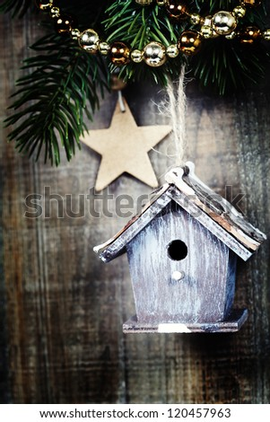 Bright christmas composition with small birdhouse