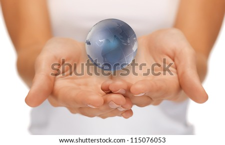bright closeup picture of woman hands holding earth globe - stock photo