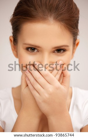 bright closeup picture of woman with hand over mouth - stock photo