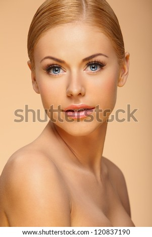 bright closeup portrait of lovely young woman with natural make-up