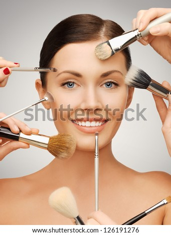 bright closeup portrait picture of beautiful woman with brushes
