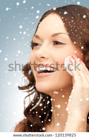 bright closeup portrait picture of beautiful woman with cotton pad