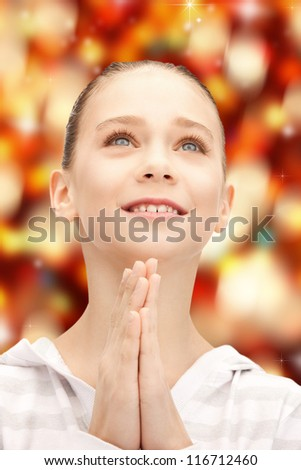 bright closeup portrait picture of praying teenage girl