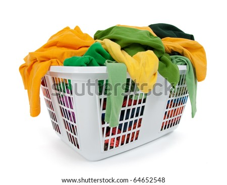 Bright clothes in a laundry basket on white background. Green, yellow.