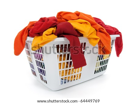 Bright clothes in a laundry basket on white background. Red, orange, yellow.