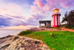 Bright coastal morning with Hornby lighthouse lighting way at the entrance to SYdney Harbour on South Headland.