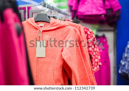 Bright color fluff jackets for girls in supermarket
