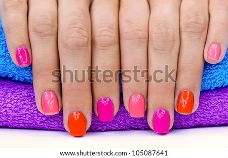 Bright color manicure on a bright background