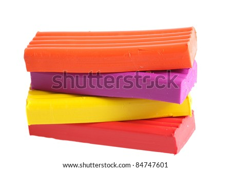 Bright color plasticine it is isolated on a white background
