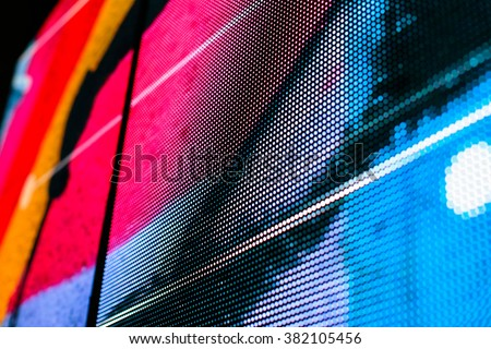 Bright colored blue LED wall with pink pattern - close up background