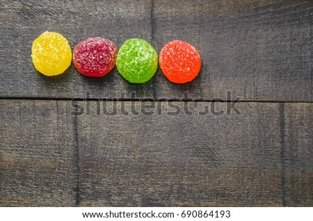 Bright colored candy, sweets, sweets on a dark background, top view #690864193