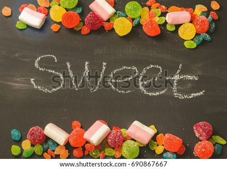 Bright colored candy, sweets, sweets on a dark background, top view #690867667