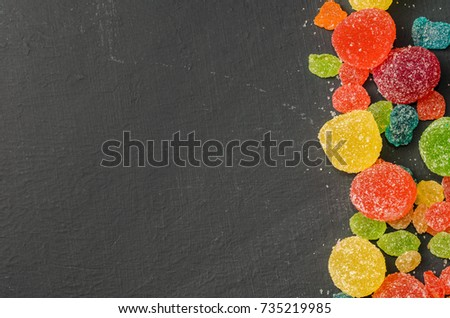 Bright colored candy, sweets, sweets on a dark background, top view #735219985
