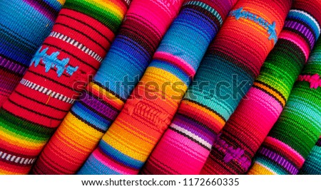Bright colored fabric as seen on the market place in mexico and peru