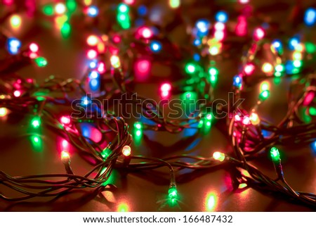 bright colored garlands bulb shines in the dark background