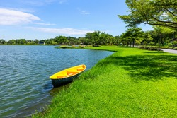 Bright colored rowboat by the river, beautiful scenery