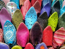 Bright colored slippers or shoes in a Marrakech market in Morocco.