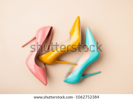 Bright colored women's shoes on a solid background. Copy space text. #1062752384
