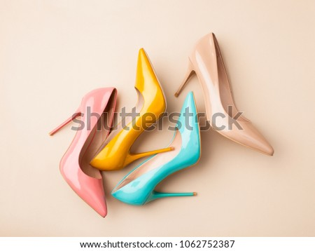 Bright colored women's shoes on a solid background. Copy space text. #1062752387