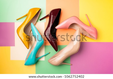 Bright colored women's shoes on a solid background. Copy space text. - Shutterstock ID 1062752402