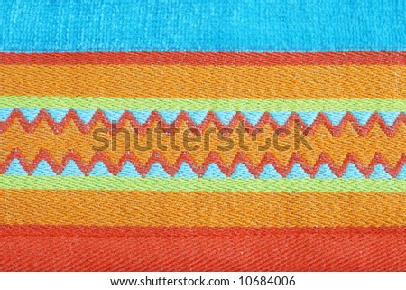 bright colorful abstract with turquoise, orange, gold, and green