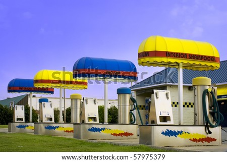 Bright colorful car wash with vacuum and shampoo machines