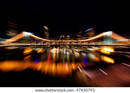 Bright, colorful city lights in motion blur - stock photo