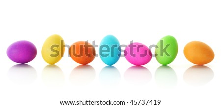 Bright, colorful Easter eggs in row, isolated on white