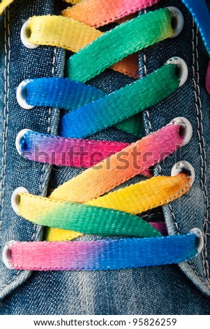 Bright colorful shoelace and sneakers - stock photo