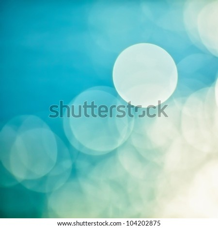 bright colorful sun and sea bokeh background