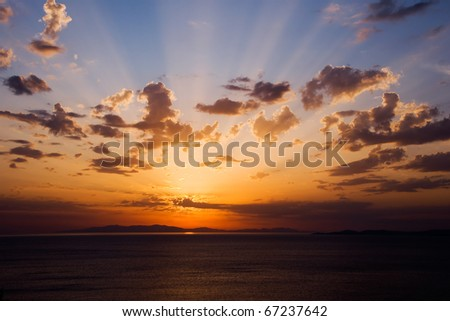 Bright colorful sunset on the sea with beautiful clouds ... - stock photo