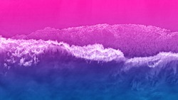 Bright colorful top view of the beach in ultraviolet neon color. Unusual combination of colors. Magical atmosphere.