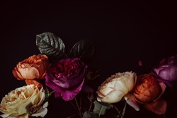 Bright colourful moody garden roses in a bunch